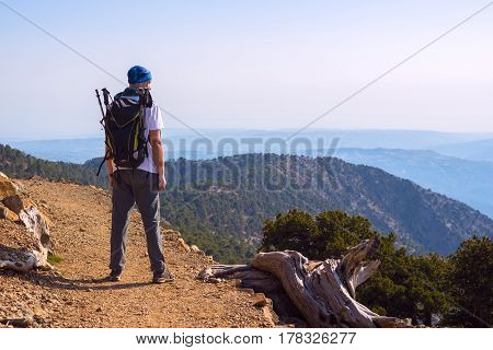 Bearded Man, Traveler With Backpack On The Mountain Trail