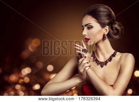 Woman Hair Bun Hairstyle Fashion Model Beauty Makeup and Red Jewelry Beautiful Girl Side View
