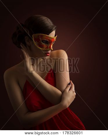 Woman Mask Sexy Fashion Model Posing in Red Carnival Masquerade Desire Girl side view