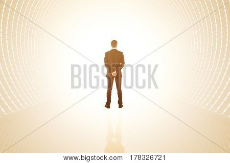 Back view of businessman in abstract bright tunnel with reflection on floor. 3D Rendering