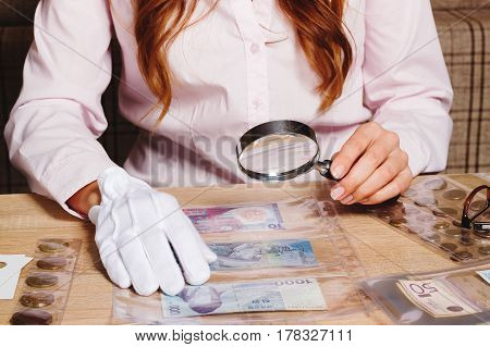 Collectible Banknotes In The Woman's Hand