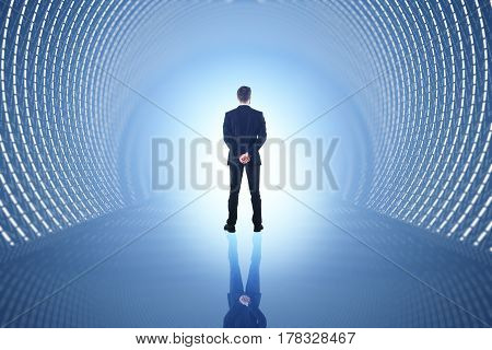 Back view of businessman in abstract blue tunnel with reflection on floor. 3D Rendering