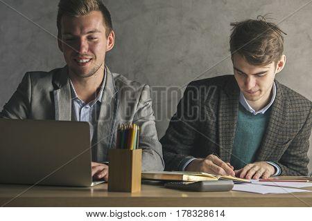 Caucasian Guys Doing Paperwork