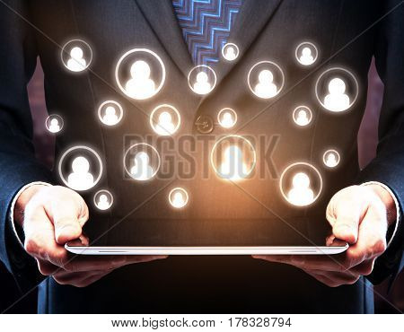 Close up of businessman's hands using tablet with abstract HR icons. Hiring concept. 3D Rendering
