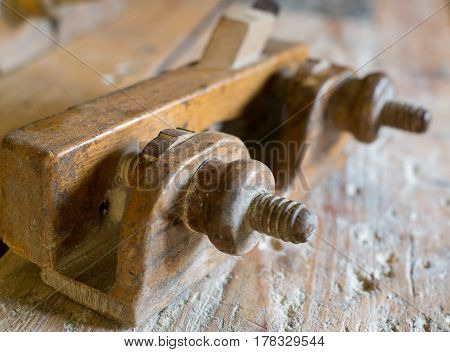 Old wooden hand plane. Joiners tool for shaping wood. Close-up.