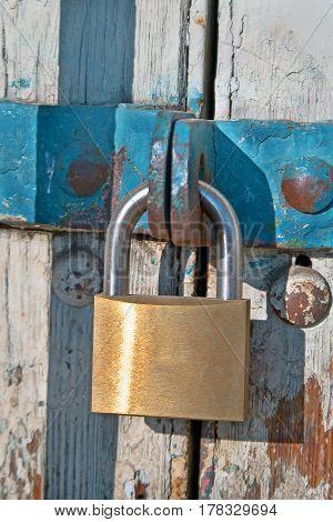 Padlock and chain on old wooden door