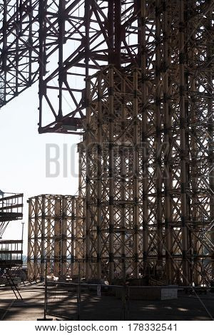 Metal scaffolding (temporary framework) on the construction site.