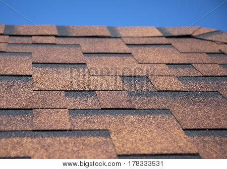 The roof of the house with red shingles