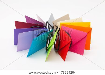 Different colored envelopes on the white table.