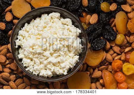 Cottage Cheese In White Dish. Prunes, Dried Apricots, Dried Mandarins And Almonds Close-up