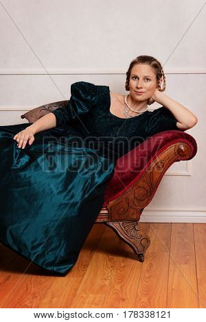 portrait victorian woman leaning on fainting couch