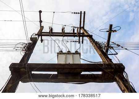 High voltage power pole with wires tangledWire and cable clutter.