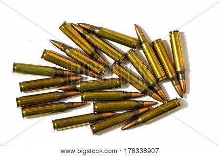 5.56x45mm NATO intermediate cartridges isolated on white background.
