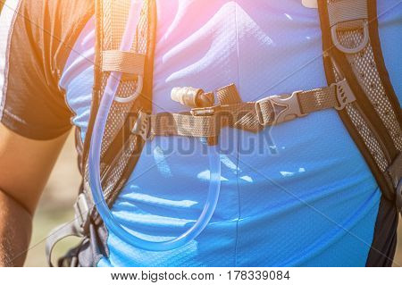 Hydration packs on a man - cyclist close-up