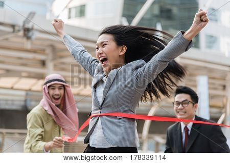 Businesswoman crossing the finish line in race competition .Business success in muti culture concept