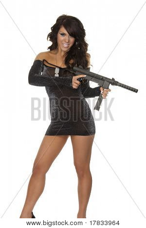 Beautiful young woman holding sub machine gun weapon isolated against white background