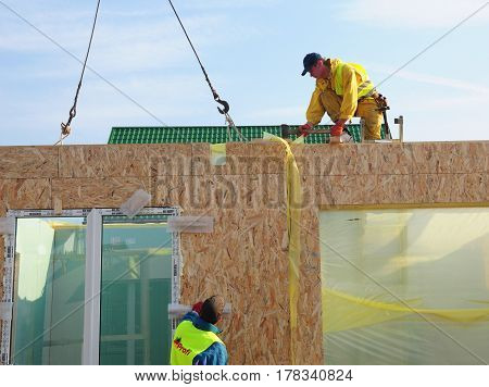 KIEV UKRAINE - March 28 2017:  Builders Installing Frame House Structural Insulated Panel - SIP. Contractors Building New Frame House.