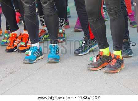 STOCKHOLM SWEDEN - MAR 25 2017: Colorful shoes of runners before the start of the race in the Stockholm Tunnel Run Citybanan 2017. March 25 2017 in Stockholm Sweden