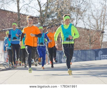STOCKHOLM SWEDEN - MAR 25 2017: Running boys and other runners in the Stockholm Tunnel Run Citybanan 2017. March 25 2017 in Stockholm Sweden