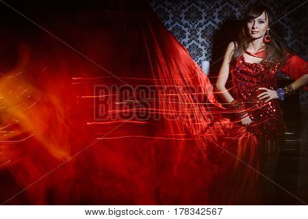 Woman In Red Waving Dress In Interior