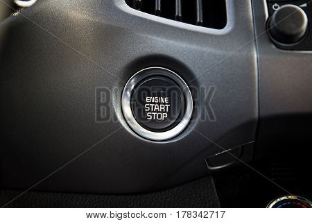 Engine start stop button. Car dashboard.  Auto inside.