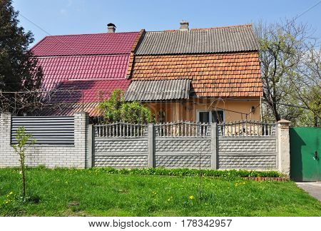 Roofing Construction. Old Roof Repair and Renovation. Roof tiles asbestos roof tiles metal roof sheets.