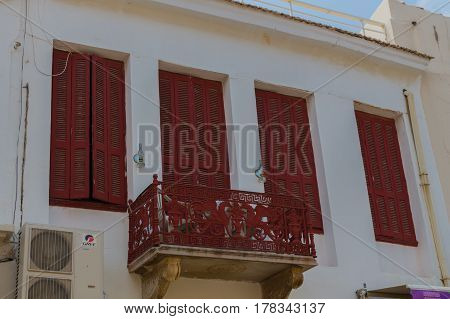 Rethymno, Greece - August  5, 2016:  Old Balcony And Windows.