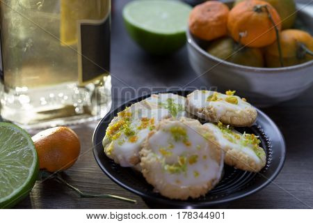 Boozy cookies with margarita frosting and orange and lime zest