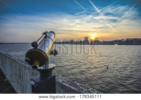 View of the Shelda River from the viewing platform of the wharf of Antwerp. Telescope with landscape,