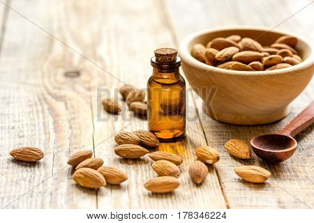 natural oil and almond in organic cosmetic set on brown wooden table background