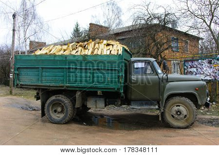 Old car fully loaded with wood for heating the furnace