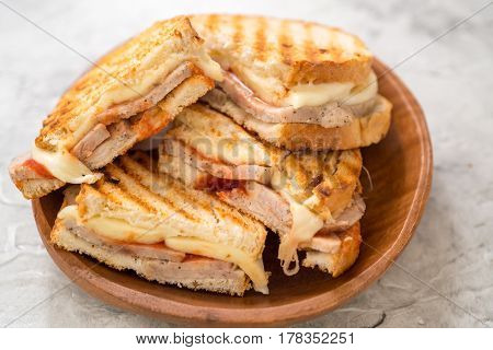 A grilled ham and swiss cheese sandwich with tomato sauce