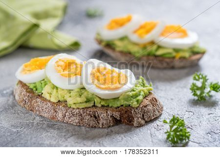 Healthy breakfast - Toast with avocado and egg