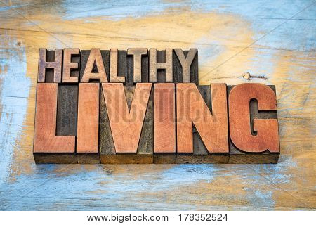 healthy living banner in vintage letterpress wood type blocks stained by color inks