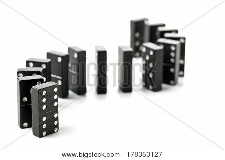 Domino game stones in a s-curve shaped row standing on white background