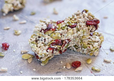 Energy bars - snack with pumpkin seeds, sunflower seed, sesame and cranberry for healthy still life