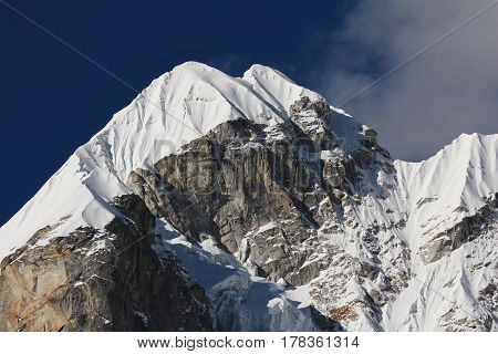 Glacier covered peak of mount Lobuche East. View from Dzongla Mount Everest National Park Nepal.
