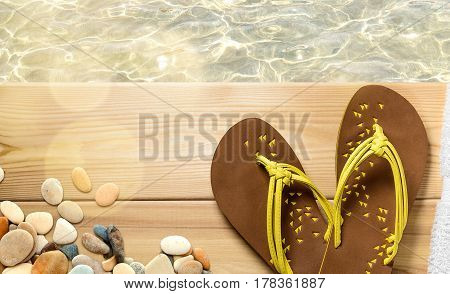 Summer beach vacation, flip flops on wood deck with clear transparent sea water on background. Top view