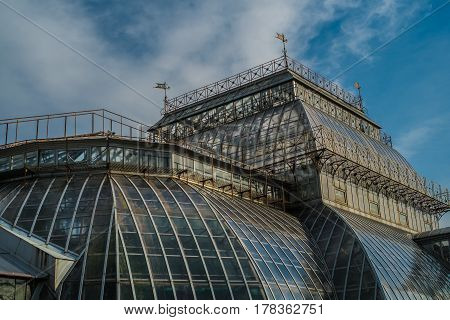 Steampunk industrial glass building with a blue  sky on a sunny day
