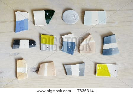 Samples of colored enamel for color ceramics ceramic working process in studio