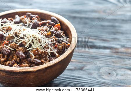 Bowl of chili con carne on the wooden table