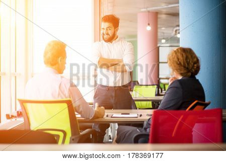 Toned of confident handsome man communicating with employees. Young bearded man knows how to get positive assessment to get job position.