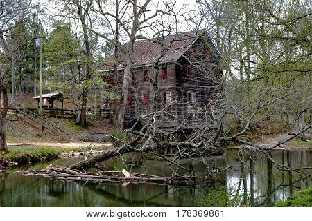 Childersburg Alabama USA - March 25 2017: Springtime at Kymulga Park. Kymulga Grist Mill on the banks of Talledega Creek is orginal to the Civil War period.