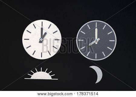 Moon & Sun clocks in a black background