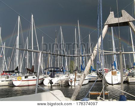 rainbow  sail sailboats  boats storm water yacht