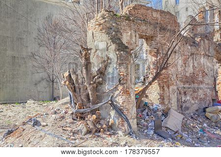 old and abandoned house with ruined walls