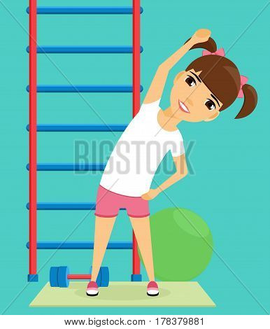 Little girl doing sport exercises in the gym. The promotion of health. The girl is engaged in gymnastics. Gymnastic ball, a dumbbell, Swedish wall.