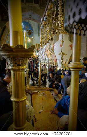 JERUSALEM ISRAEL - MARCH 25 2017: Stone of Chrismation in the Church of the Holy Sepulcher