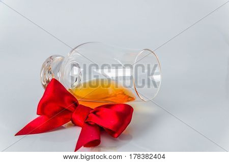 Single Malt Whiskey Glass With Red Bow On A White Background