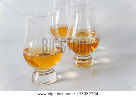 Delicious Single Malt Whiskey Glass With Another Glasses On A White Background